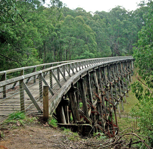 Image of a curving wooden trestle bridge